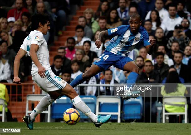 Jesus Vallejo of Real Madrid and Diego Rolan of Malaga vie for the ball during the La Liga match between Real Madrid and Malaga at Santiago Bernabeu...