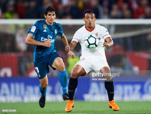 Jesus Vallejo of Real Madrid CF competes for the ball with Luis Muriel Sevilla FC during the La Liga match between Sevilla FC and Real Madrid at...