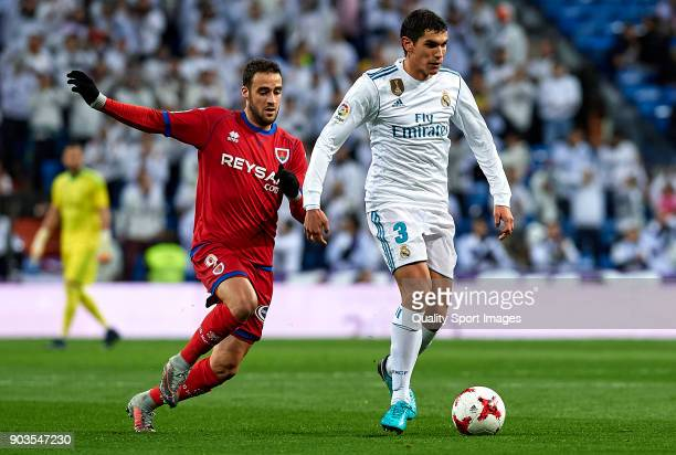 Jesus Vallejo of Real Madrid competes for the ball with Higinio of Numancia during the Copa del Rey Round of 16 second Leg match between Real Madrid...