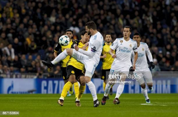 Jesus Vallejo of Real Madrid in action against Shinji Kagawa of Borussia Dortmund during the UEFA Champions League group H match between Real Madrid...