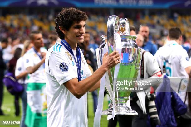 Jesus Vallejo of Real Madrid poses with the trophy following the UEFA Champions League final between Real Madrid and Liverpool at the NSC Olimpiyskiy...