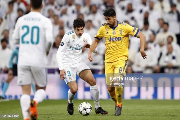 Jesus Vallejo of Real Madrid Sami Khedira of Juventus FC during the UEFA Champions League quarter final match between Real Madrid and Juventus FC at...
