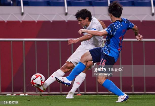 Jesus Vallejo of Spain and Yuki Soma of Japan battle for the ball during the Men's Football Semi-final Match between Japan and Spain at Saitama...