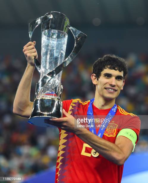 Jesus Vallejo of Spain celebrates with the trophy winning the 2019 UEFA U-21 Final between Spain and Germany at Stadio Friuli on June 30, 2019 in...