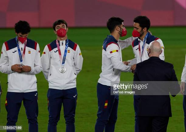 Jesus Vallejo of Spain, Eric Garcia of Spain, Marco Asensio of Spain and Mikel Merino of Spain during the medal ceremony during the Men's Gold Medal...