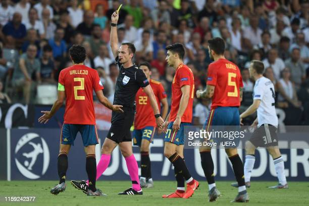Jesus Vallejo of Spain is shown a yellow card by the referee Srdjan Jovanovic during the 2019 UEFA U-21 Final between Spain and Germany at Stadio...