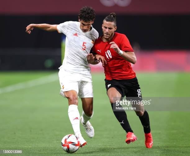 Jesus Vallejo of Team Spain is challenged by Ramadan Sobhi of Team Egypt during the Men's First Round Group C match between Egypt and Spain during...