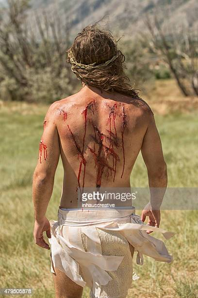 jesus walking with wounds on back - jesus blood stock pictures, royalty-free photos & images