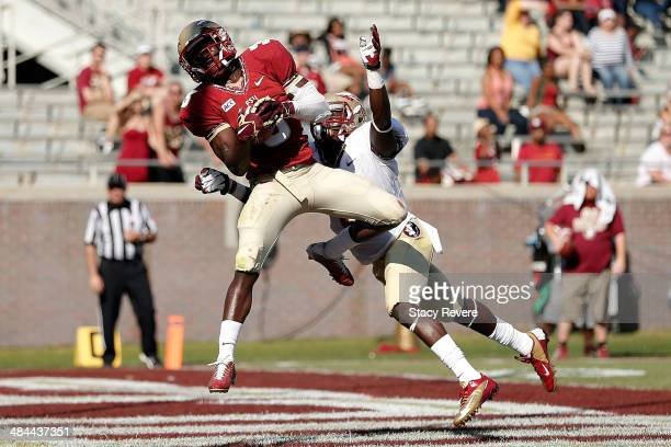 Jesus Wilson of the Garnet team catches a touchdown pass in front of Nick Waisome of the Gold team during Florida State's Garnet and Gold spring game...