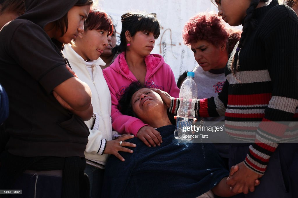 Jesusita Cardoza grieves at the scene of the murder of her two daughters aged 17 and 21 March 24, 2010 in Juarez, Mexico. Secretary of State Hillary Rodham Clinton, Defense Secretary Robert Gates, and Homeland Security Secretary Janet Napolitano all visited Mexico on yesterday for discussions centered on Mexico's endemic drug-related violence. The border city of Juarez, Mexico has been racked by violent drug-related crime recently and has quickly become one of the most dangerous cities in the world in which to live. As drug cartels have been fighting over ever-lucrative drug corridors along the United States border, the murder rate in Juarez has risen to 173 slayings for every 100,000 residents. President Felipe Calderon's strategy of sending 7000 troops to Juarez has not mitigated the situation. With a population of 1.3 million, 2,600 people died in drug-related violence last year and 500 so far this year, including two Americans recently who worked for the U.S. Consulate and were killed as they returned from a child's party.