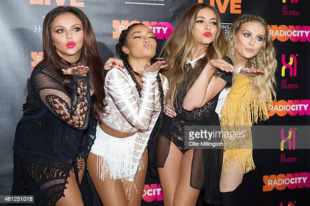 Jesy Nelson LeighAnne Pinnock Jade Thirlwall and Perrie Edwards of Little Mix celebrate getting number 1 UK single backstage at Echo Arena on July 18...