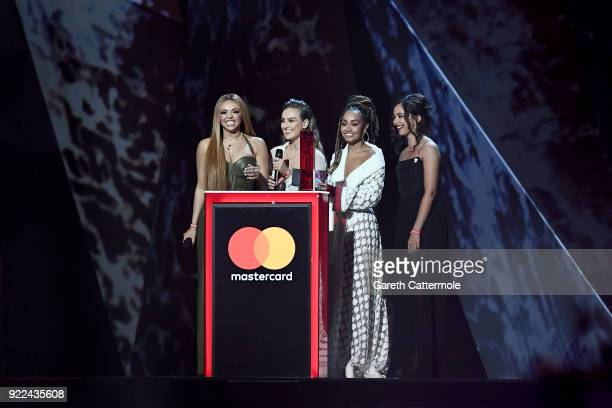 AWARDS 2018 *** Jesy Nelson Perrie Edwards LeighAnne Pinnock and Jade Thirlwall of Little Mix speak on stage at The BRIT Awards 2018 held at The O2...
