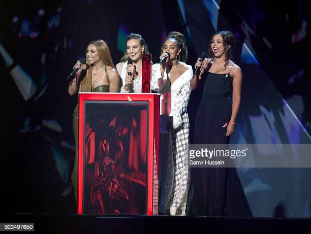 AWARDS 2018 *** Jesy Nelson Perrie Edwards LeighAnne Pinnock and Jade Thirlwall of Little Mix present on stage at The BRIT Awards 2018 held at The O2...