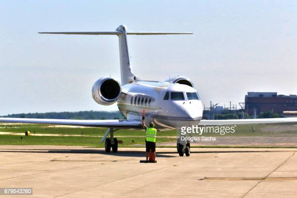 jet aircraft on the airport tarmac - taxiing stock pictures, royalty-free photos & images