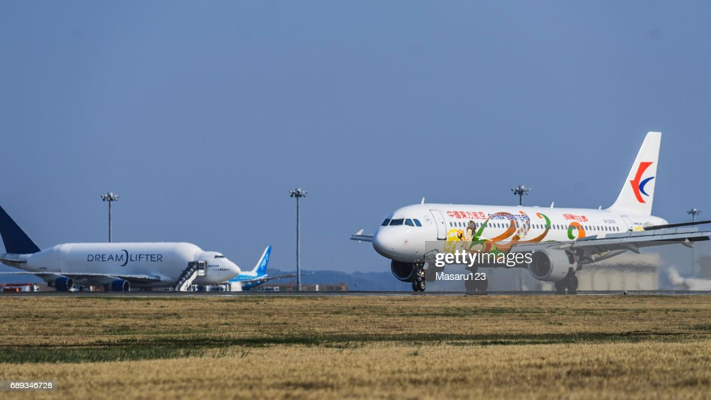 Jet airplane from China running to the terminal of Centrair airport : Stock Photo