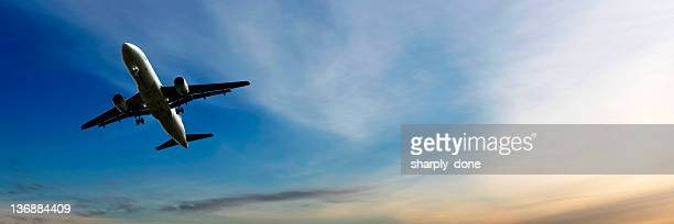 jet airplane landing at dusk - a320 stock pictures, royalty-free photos & images