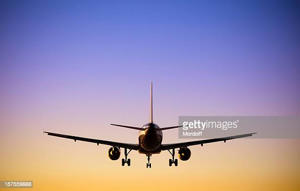 jet airplane landing at dusk - airbus a320 stock pictures, royalty-free photos & images