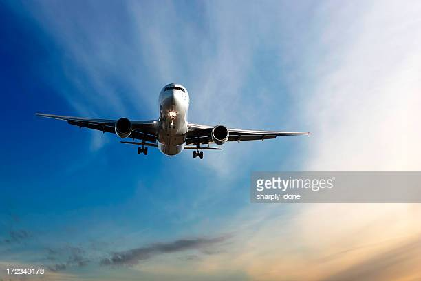 jet airplane landing at dusk - cargo airplane stock photos and pictures