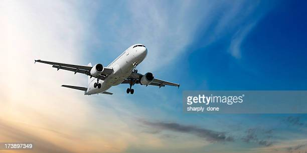 xxl jet airplane landing at dusk - aeroplane stock pictures, royalty-free photos & images