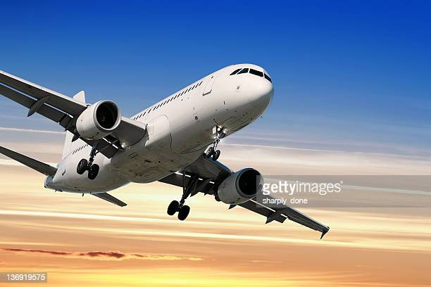 jet airplane landing at sunset - airbus a320 stock pictures, royalty-free photos & images