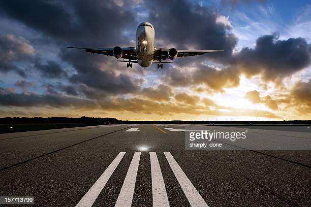 xxl jet airplane landing at sunset - airfield stock pictures, royalty-free photos & images