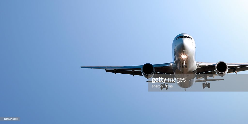 jet airplane landing in blue sky : Stock Photo