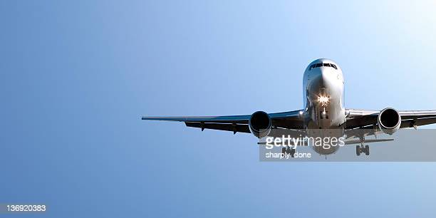jet airplane landing in blue sky