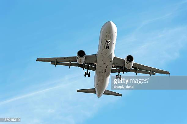 xxl jet airplane landing in bright sky - a320 stock pictures, royalty-free photos & images