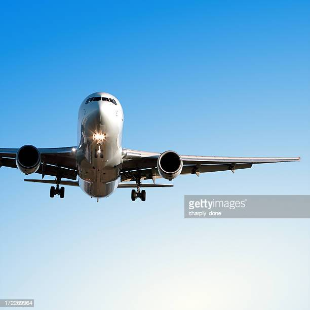 jet airplane landing in clear blue sky
