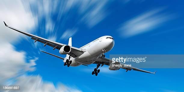 jet Avión aterrizando en movimiento borroso sky