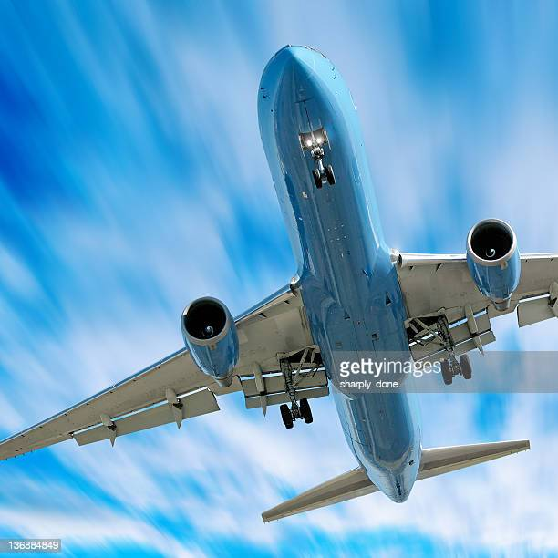 jet airplane landing in motion blur sky