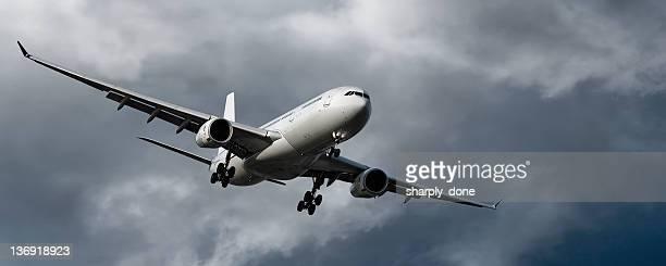 jet airplane landing in storm