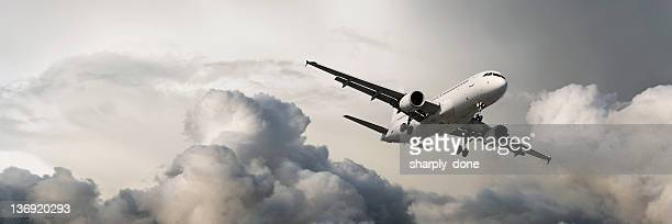 xxxl jet airplane landing in storm - airbus a320 stock pictures, royalty-free photos & images