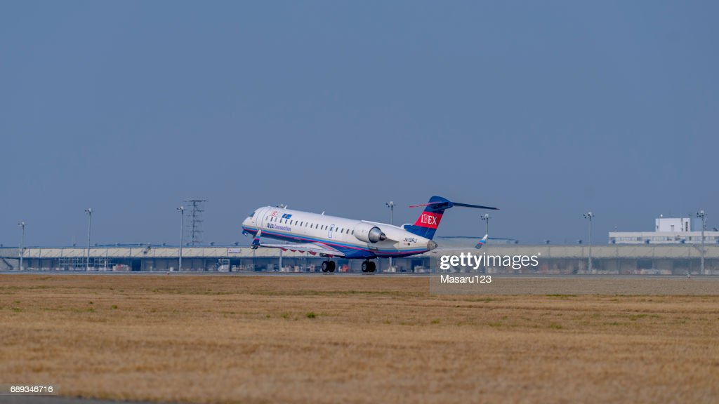 Jet airplane taking off from the Centrair Airport : Stock Photo