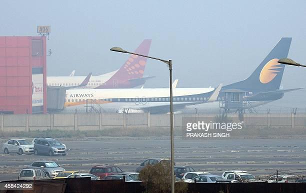 A Jet Airways Boeing 737800 aircraft is seen at Terminal 3 of Indira Gandhi International airport in New Delhi on November 5 2014 Jet Airways...