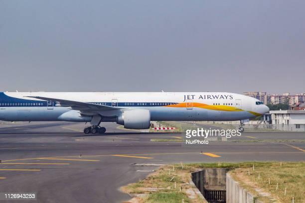 Jet Airways Boeing 777300 airplane taxiing in Delhi Indira Gandhi International Airport DEL / VIDP in India The Jet Airways 9W Airplane has the...