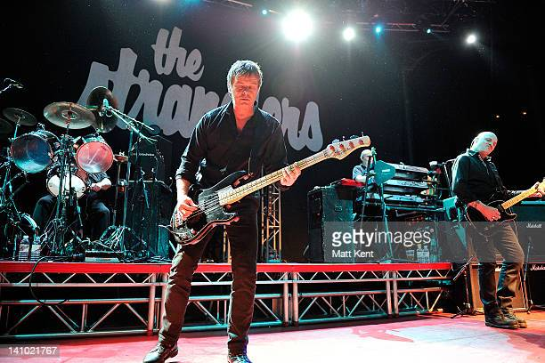 Jet Black JeanJacques Burnel Dave Greenfield and Baz Warne of The Stranglers perform on stage at The Roundhouse on March 9 2012 in London United...