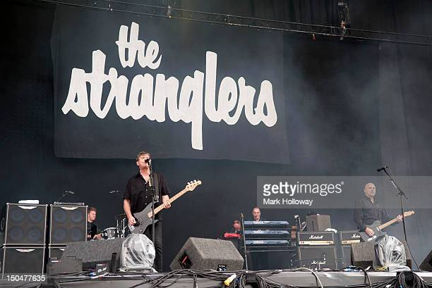 Jet Black JeanJacques Burnel Dave Greenfield and Baz Warne of the Stranglers performs on stage during V Festival on August 19 2012 in Chelmsford...