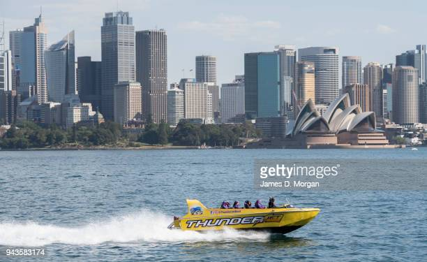 A jet boat thrill ride for tourists speeds across the harbour on April 9 2018 in Sydney Australia Sydney has been experiencing unseasonably high...