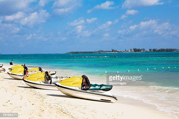 jet boats on the beach, cable beach, nassau, bahamas - nassau stock photos and pictures