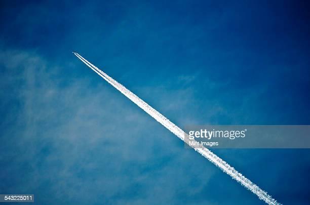 A jet contrail, a vapour trail across the sky.