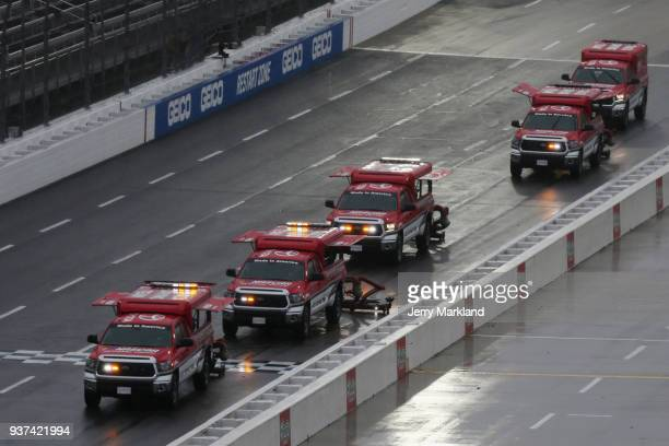 Jet dryers dry the track after the NASCAR Camping World Truck Series Alpha Energy Solutions 250 is postponed at Martinsville Speedway on March 24...