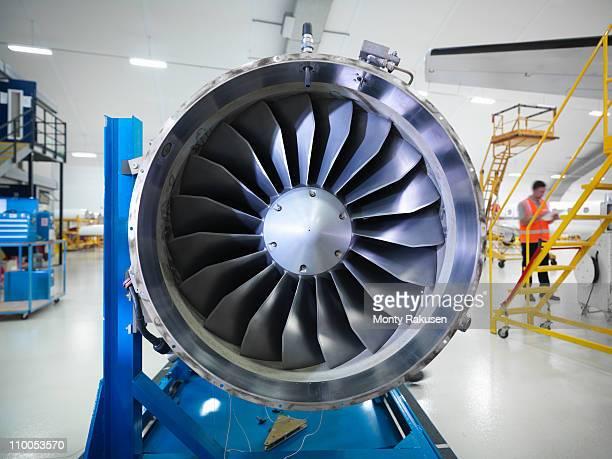Jet engine in aircraft hangar