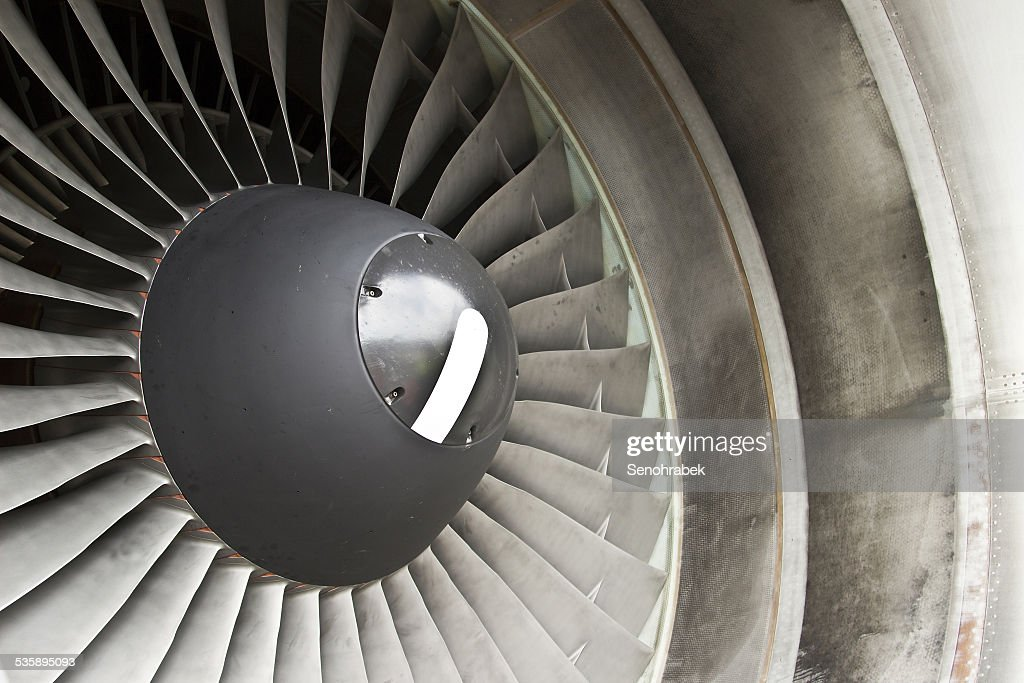 Jet engine in modern airplane : Stock Photo