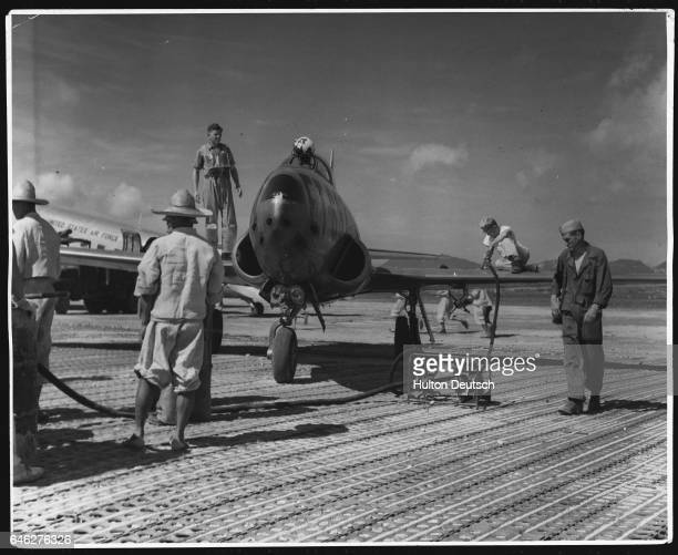 US Jet Fighter Being Refuelled On Pusan Airfield Following the crossing of the 38th Parallel by North Korean troops and the United Nations...