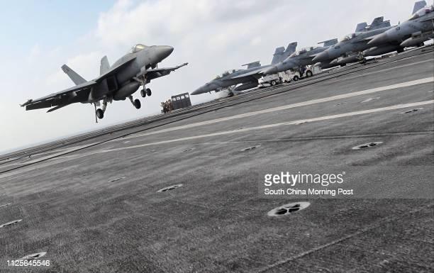 A jet fighter landed on USS George Washington 07NOV13
