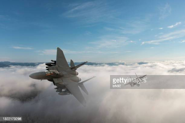 jet fighters flying over the clouds. - us air force stock pictures, royalty-free photos & images