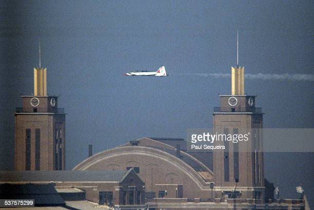 A jet flies above Navy Pier during the Chicago Air and Water Show Chicago Illinois 1980s