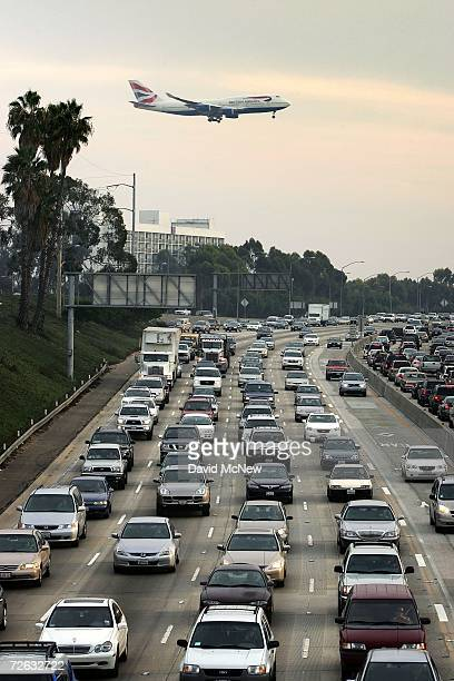 A jet flies over congested traffic on the 405 freeway as it comes in to land at Los Angeles International Airport on Thanksgiving eve traditionally...