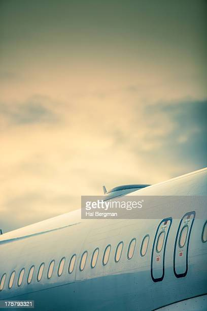 jet fuselage and emergency exits - fuselage stock photos and pictures